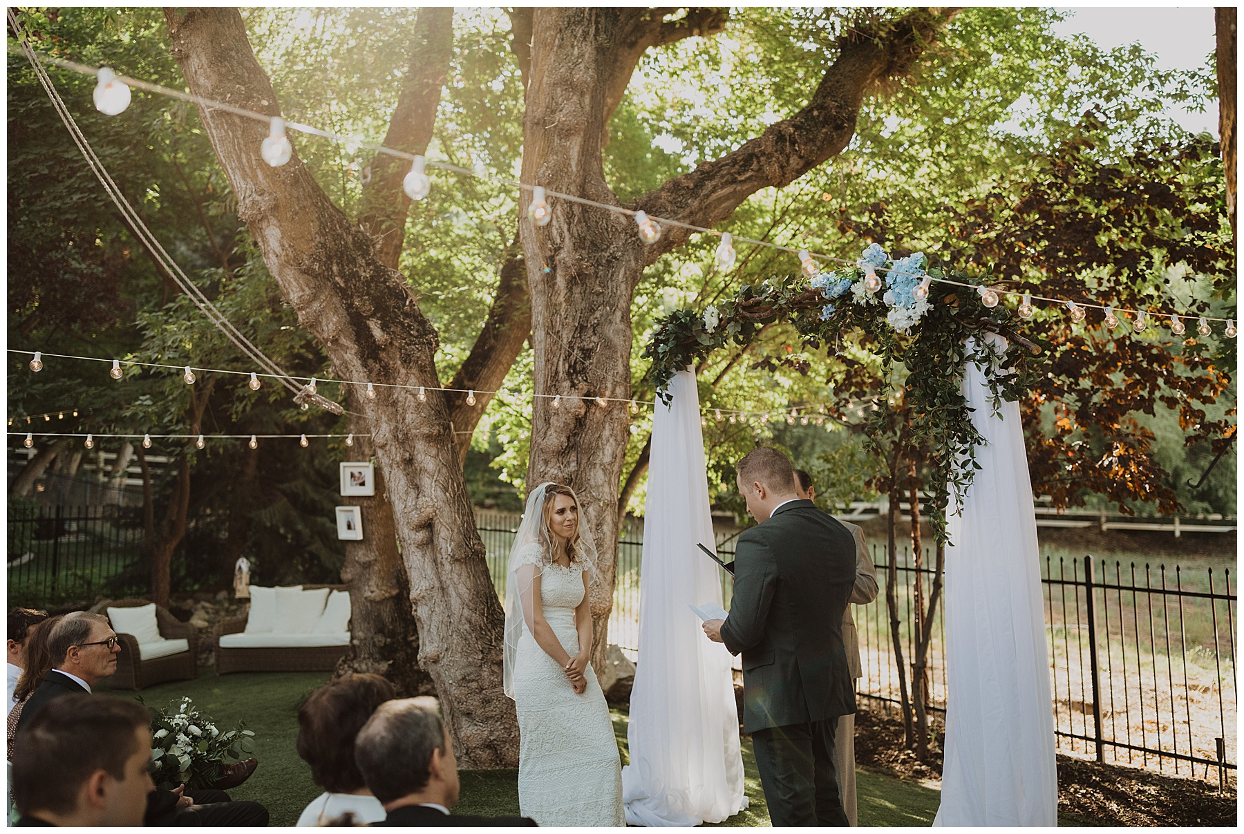 Bride and groom saying their vows at a backyard wedding in Ogden Utah