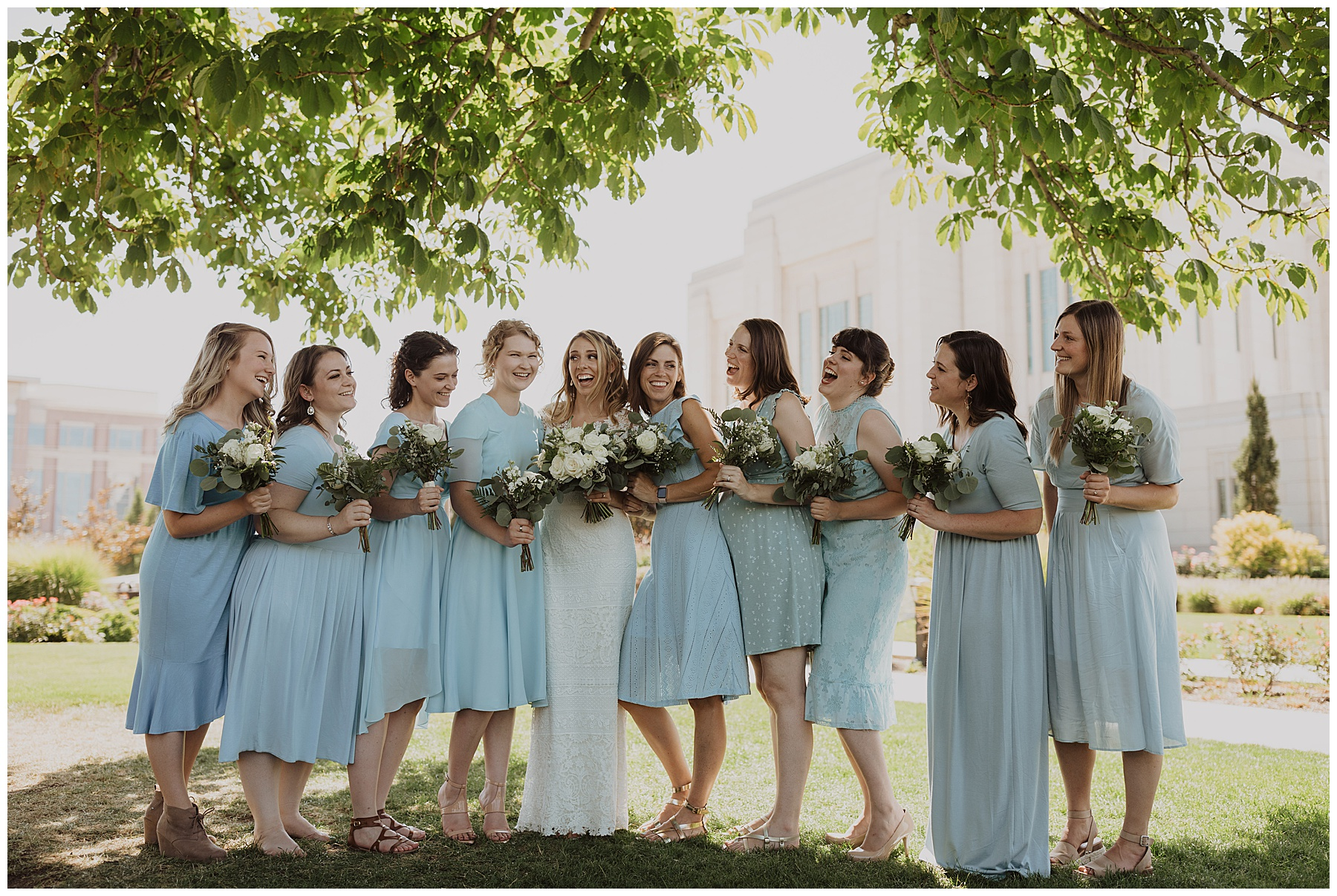 Bride with her bridesmaids wearing baby blue at a summer wedding in Utah