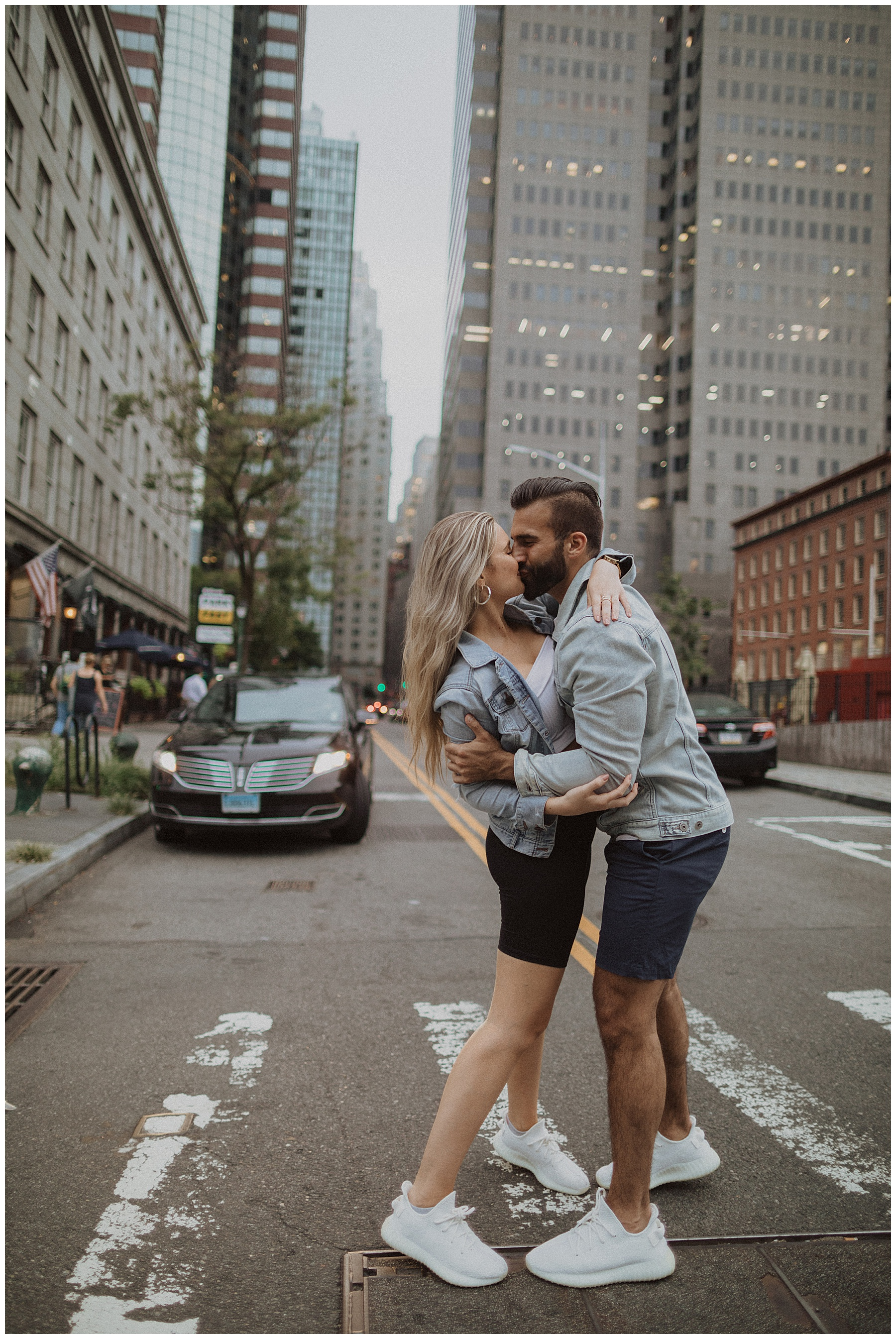 Couple making out at a crosswalk in New York City financial district